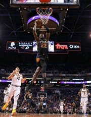 Deandre Ayton rises up for a dunk against the Nuggets during the second half of a game Jan. 12 at Talking Stick Resort Arena.