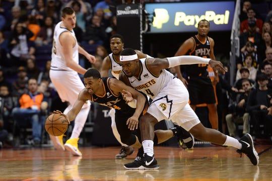 Jan 12, 2019; Phoenix, AZ, USA; Phoenix Suns guard De'Anthony Melton (14) and Denver Nuggets forward Paul Millsap (4) go after a loose ball during the second half. (Joe Camporeale-USA TODAY Sports)