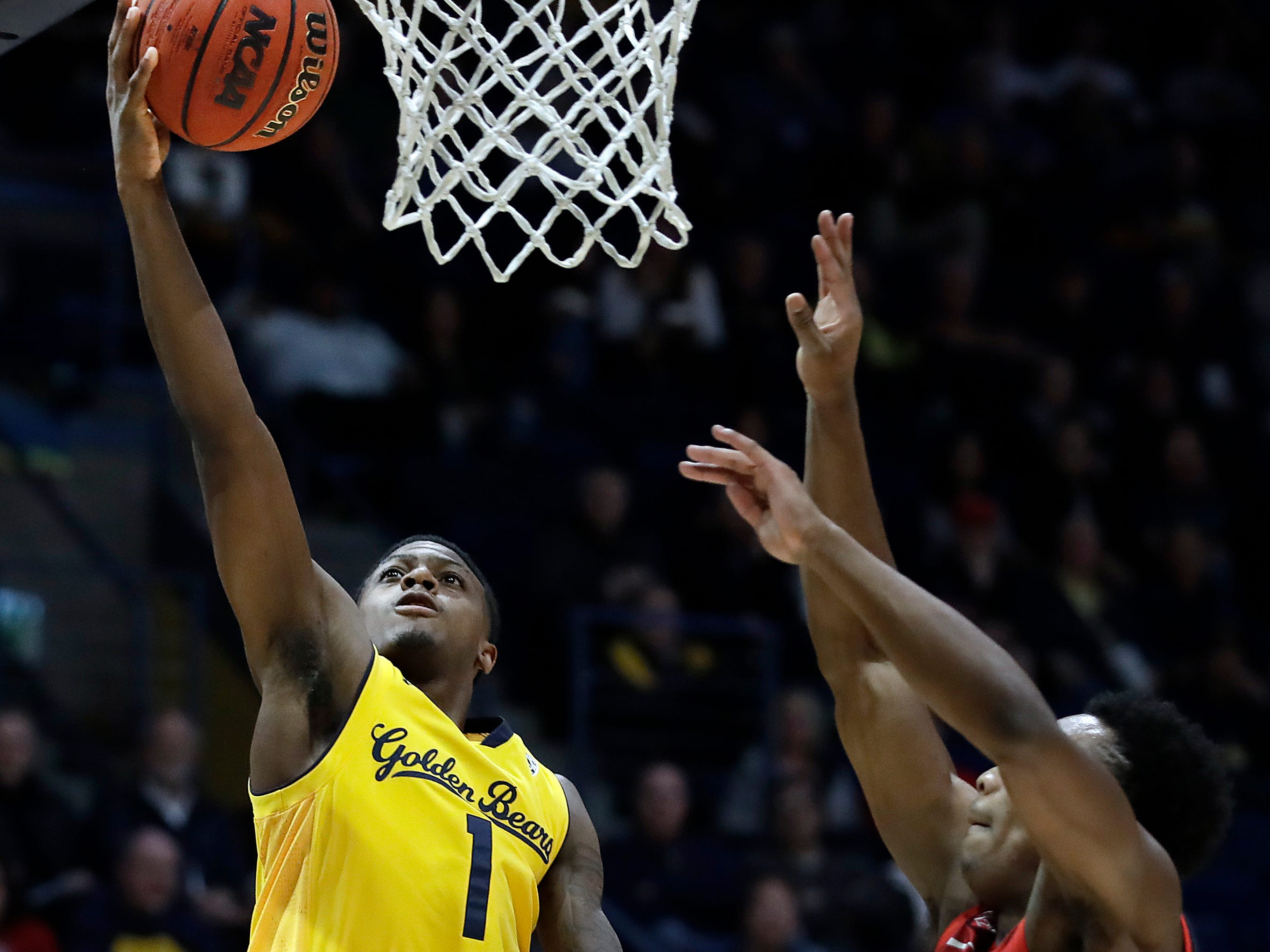 California's Darius McNeill, left, lays up a shot against Arizona's Brandon Williams (2) during the first half of an NCAA college basketball game Saturday, Jan. 12, 2019, in Berkeley, Calif. (AP Photo/Ben Margot)