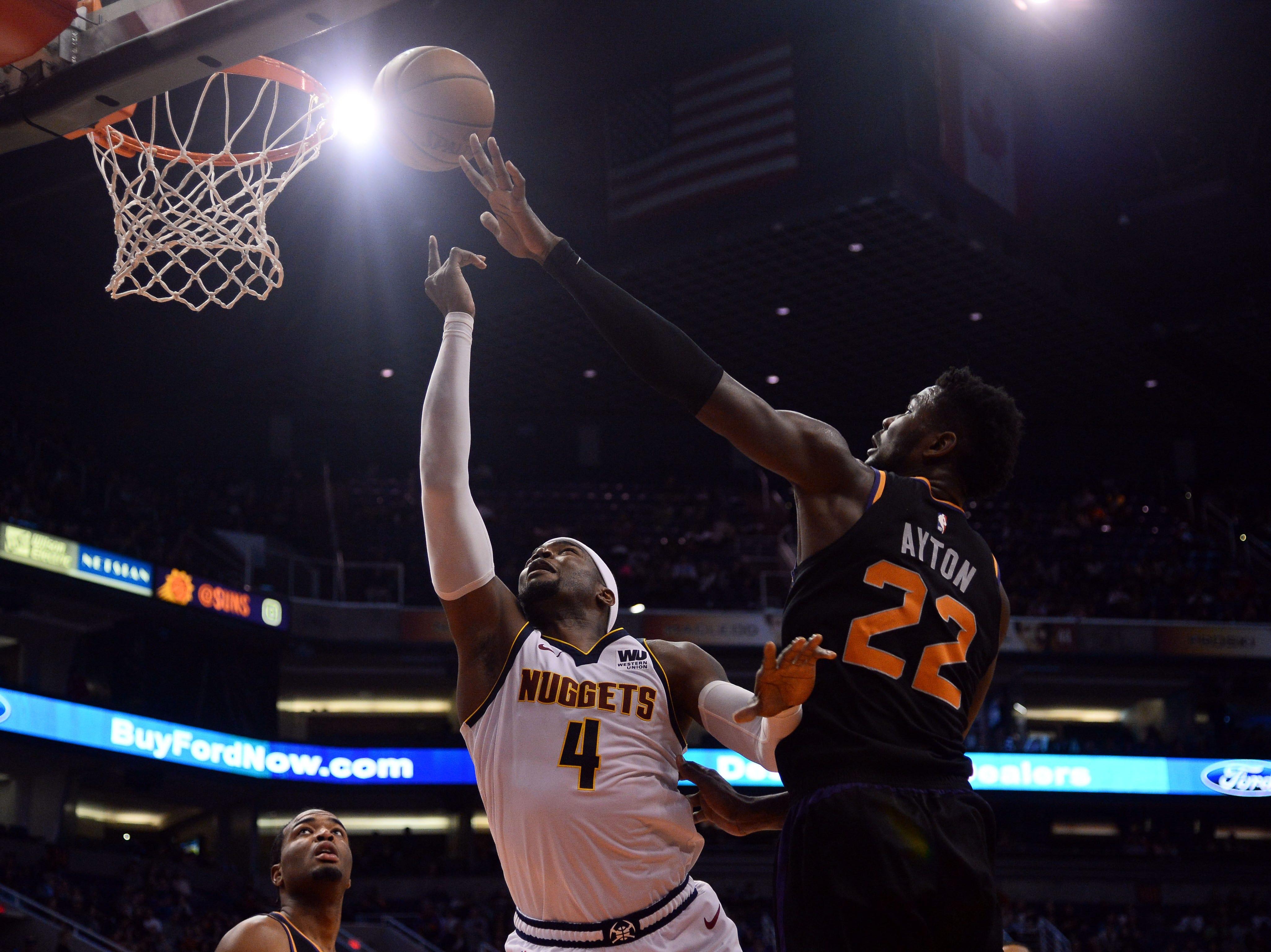 Jan 12, 2019; Phoenix, AZ, USA; Phoenix Suns center Deandre Ayton (22) blocks a shot by Denver Nuggets forward Paul Millsap (4) during the second half at Talking Stick Resort Arena. (Joe Camporeale-USA TODAY Sports)
