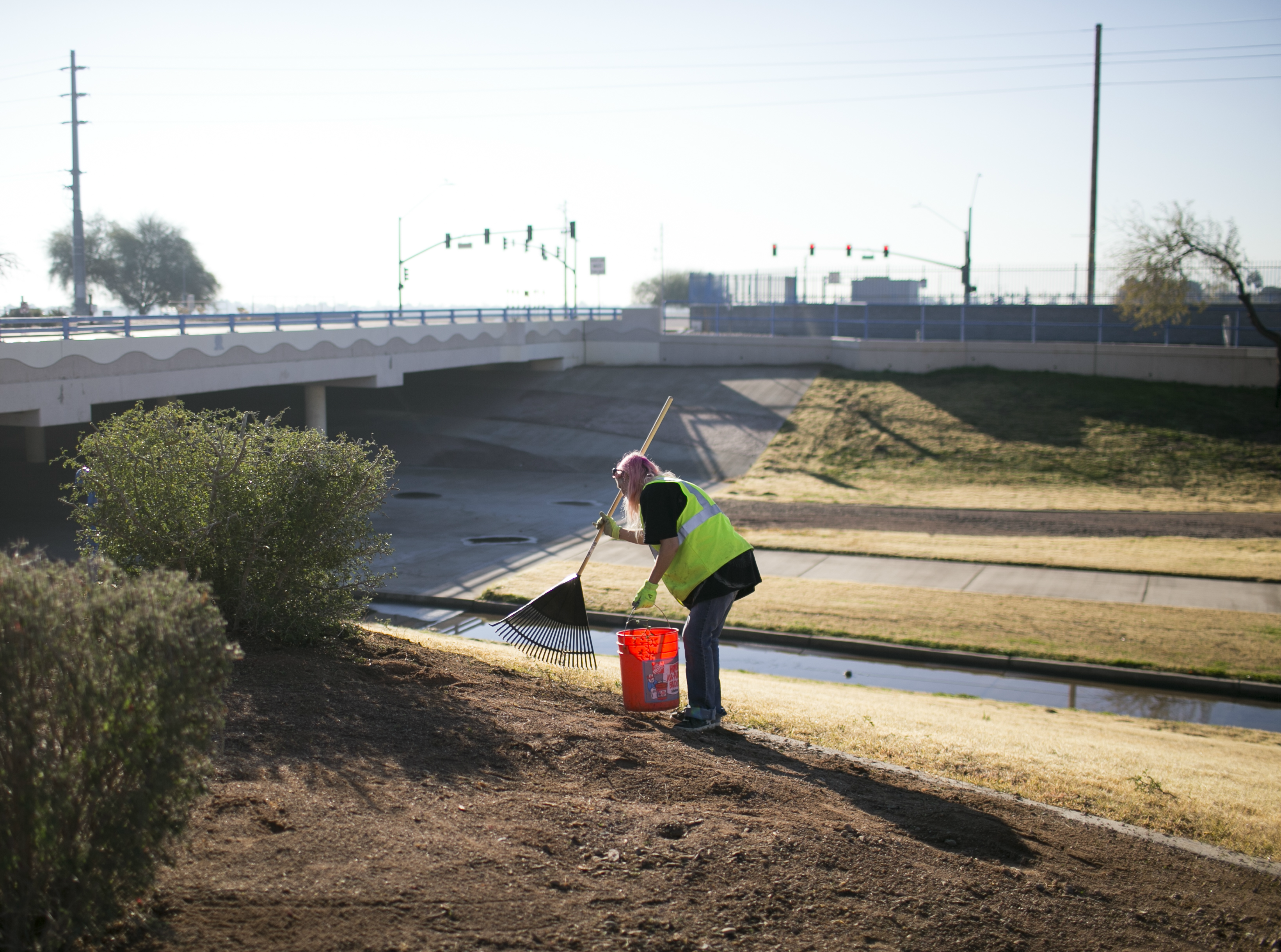 Sherry Millegan helps clean Grand Canal Linear Park as part of the Phoenix Rescue Mission's Glendale Works program on Jan. 7, 2019 in Glendale, Arizona. The Glendale Works program was started by Phoenix Rescue Mission in November of 2018 as an opportunity to get homeless persons working and making an income.