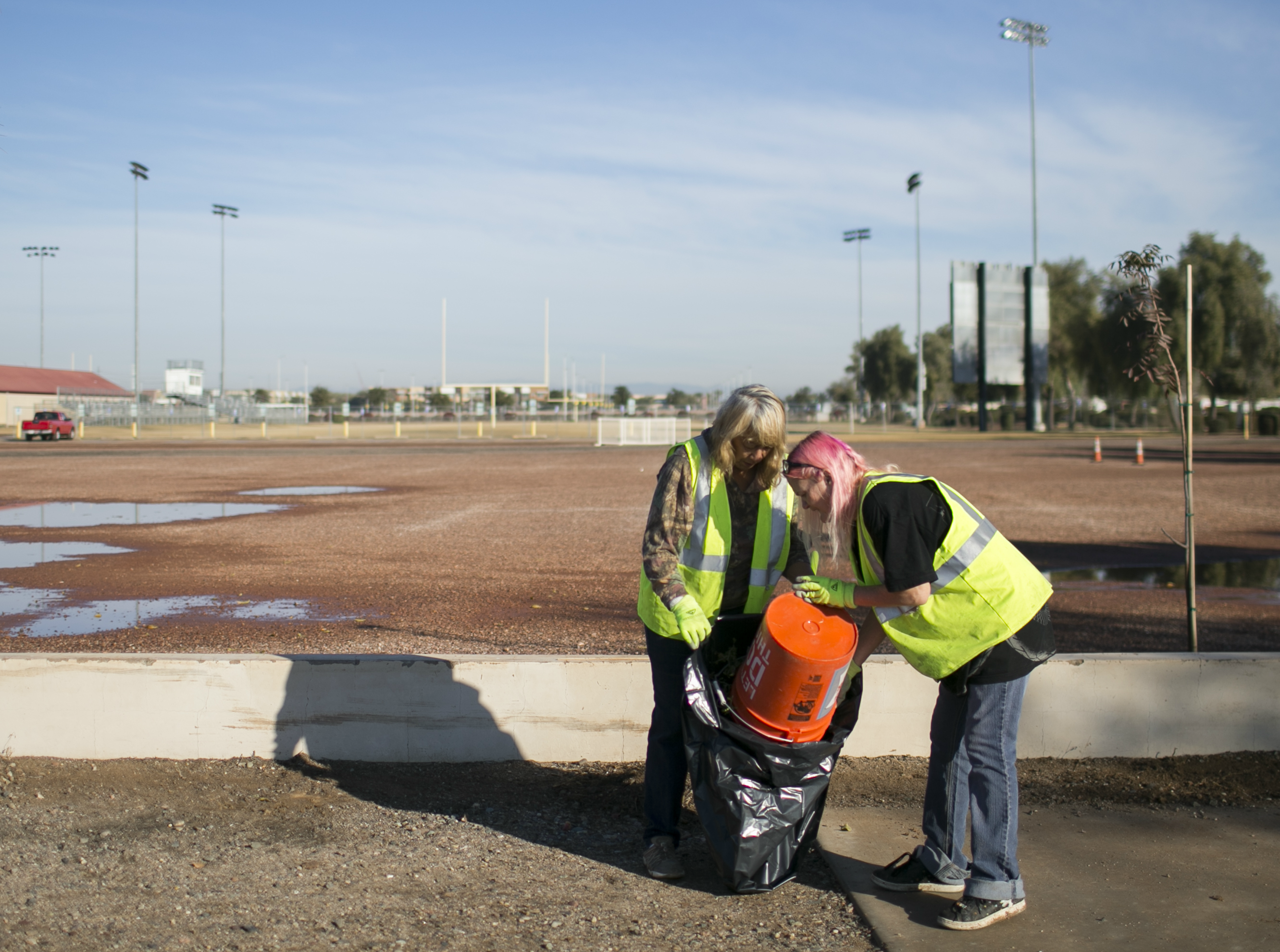 Jeanette Herring (left) alongside Sherry Millegan (right) help clean Grand Canal Linear Park as part of the Phoenix Rescue Mission's Glendale Works program on Jan. 7, 2019 in Glendale, Arizona. The Glendale Works program was started by Phoenix Rescue Mission in November of 2018 as an opportunity to get homeless persons working and making an income.