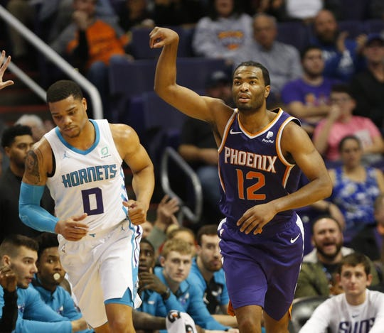 Phoenix Suns forward T.J. Warren (12) holds his hand up after a three-point field goal against the Charlotte Hornets during the fourth quarter in Phoenix January 6, 2019.