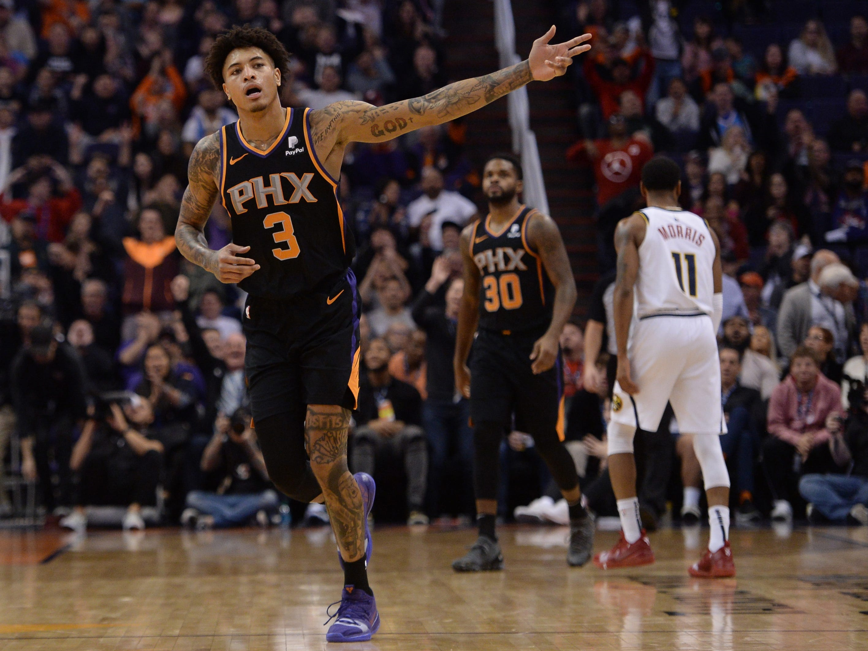 Jan 12, 2019; Phoenix, AZ, USA; Phoenix Suns forward Kelly Oubre Jr. (3) celebrates after making a buzzer beater three point shot against the Denver Nuggets during the second half. (Joe Camporeale-USA TODAY Sports)