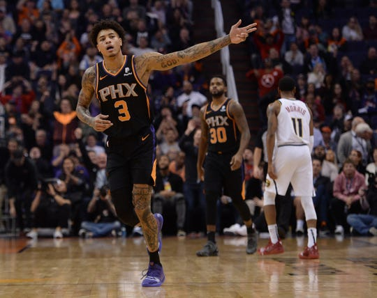 Jan 12, 2019; Phoenix, AZ, USA; Phoenix Suns forward Kelly Oubre Jr. (3) celebrates after making a buzzer beater three point shot against the Denver Nuggets during the second half. (Joe Camporeale-USA TODAY Sports) Jan 12, 2019; Phoenix, AZ, USA; Phoenix Suns forward Kelly Oubre Jr. (3) celebrates after making a buzzer beater three point shot against the Denver Nuggets during the second half. (Joe Camporeale-USA TODAY Sports) <meta itemprop=