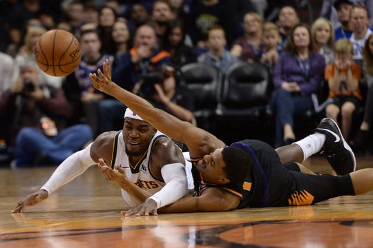 Jan 12, 2019; Phoenix, AZ, USA; Phoenix Suns guard De'Anthony Melton (14) and Denver Nuggets forward Paul Millsap (4) go after a loose ball during the second half. (Joe Camporeale-USA TODAY Sports)