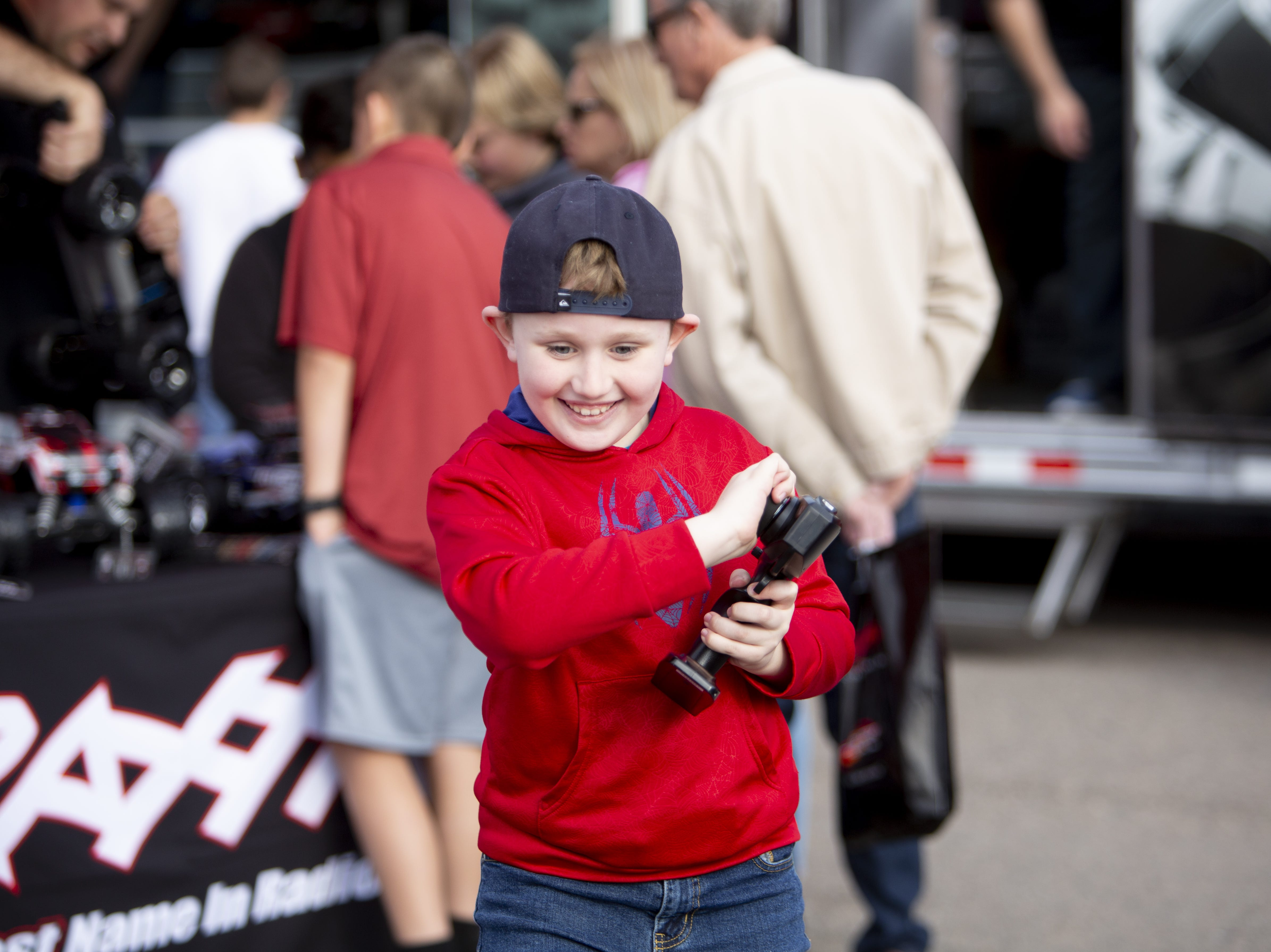Josh Peczek, 8, experiments with a Traxxas off-road remote control car at the Barrett-Jackson Car Auction on Jan. 12, the first day of the event.