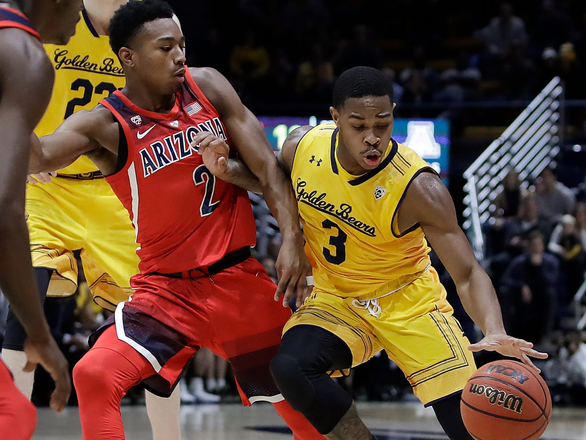 California's Paris Austin, right, drives the ball against Arizona's Brandon Williams (2) during the first half of an NCAA college basketball game Saturday, Jan. 12, 2019, in Berkeley, Calif. (AP Photo/Ben Margot)