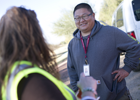 Gabe Priddy (right) a case manager assistant with Phoenix Rescue Mission speaks with a client at the Glendale Works program on Jan. 7, 2019 in Glendale, Arizona.
