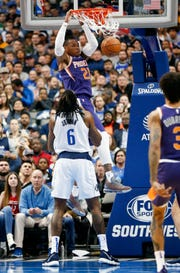 Phoenix Suns forward Richaun Holmes (21) dunks the ball in front of Dallas Mavericks center DeAndre Jordan (6) during the second half of an NBA basketball game, Wednesday, Jan. 9, 2019, in Dallas. The Mavericks won 104-94. (AP Photo/Jim Cowsert)
