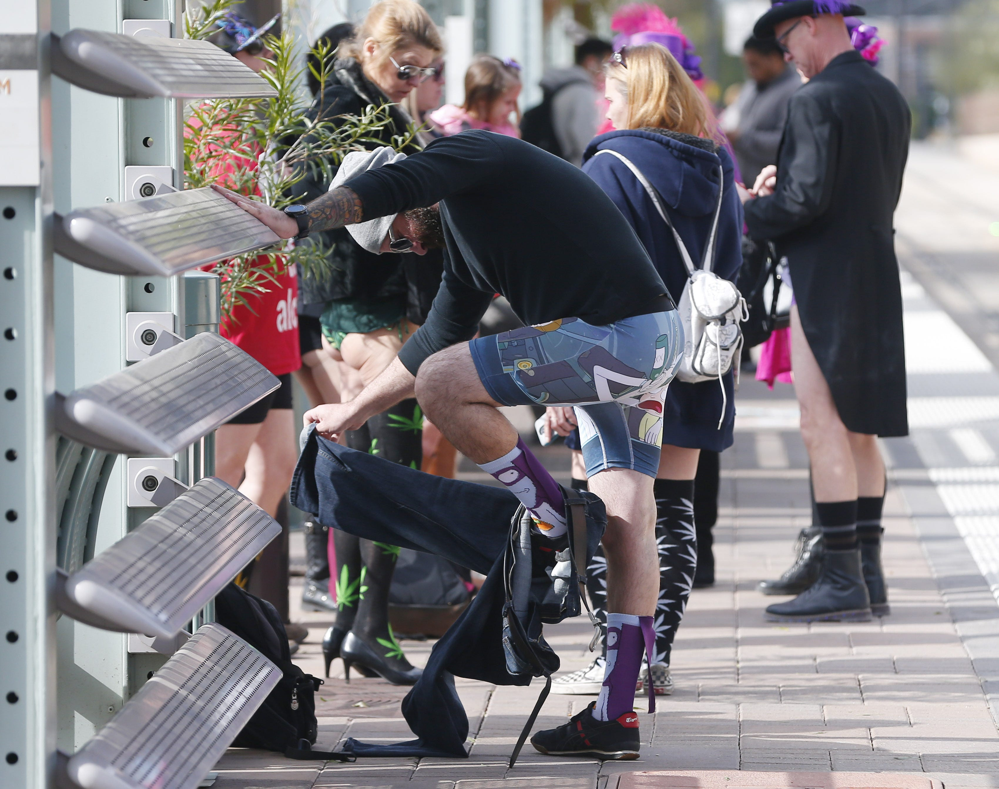 Dozens of light rail riders shed pants in annual tradition