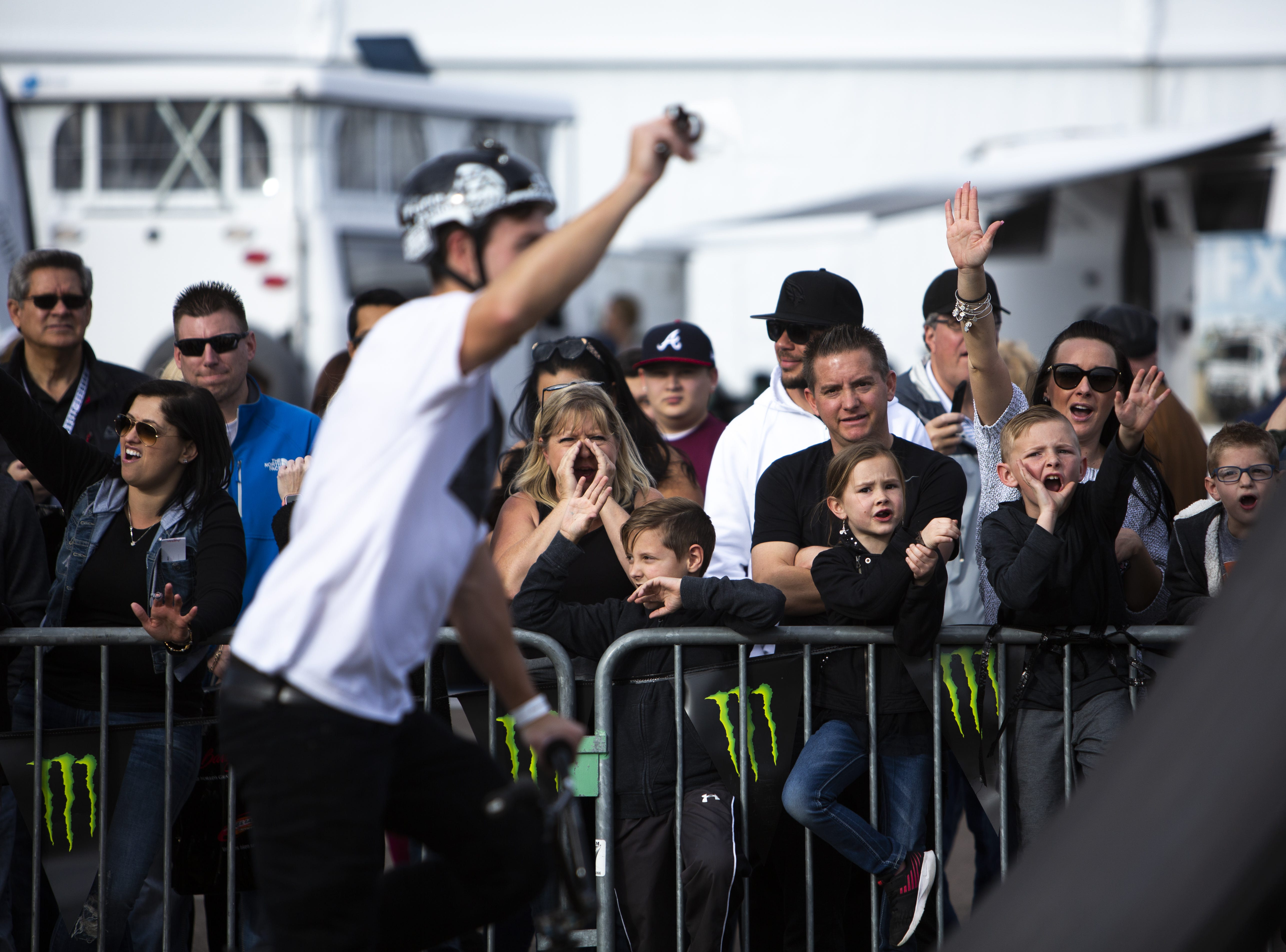 A crowd cheers on members of of the Monster Energy BMX team at the Barrett-Jackson Car Auction on Jan. 12, the first day of the event.