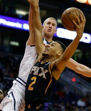 Phoenix Sun's guard Elie Okobo (2) drives Denver Nuggets center Mason Plumlee during the second half, Saturday, Jan. 12, 2019, in Phoenix. (AP Photo / Rick Scuteri)