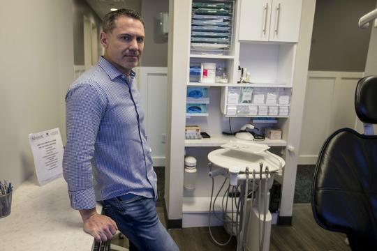 Chris Anderson, CEO of Dental Genie, poses for a portrait, Jan. 11, 2019, at Symen VanderLinden's dentist office in Chandler. Dental Genie is an online dental marketplace startup that allows patients to find dental care based on reviews, price and other factors.