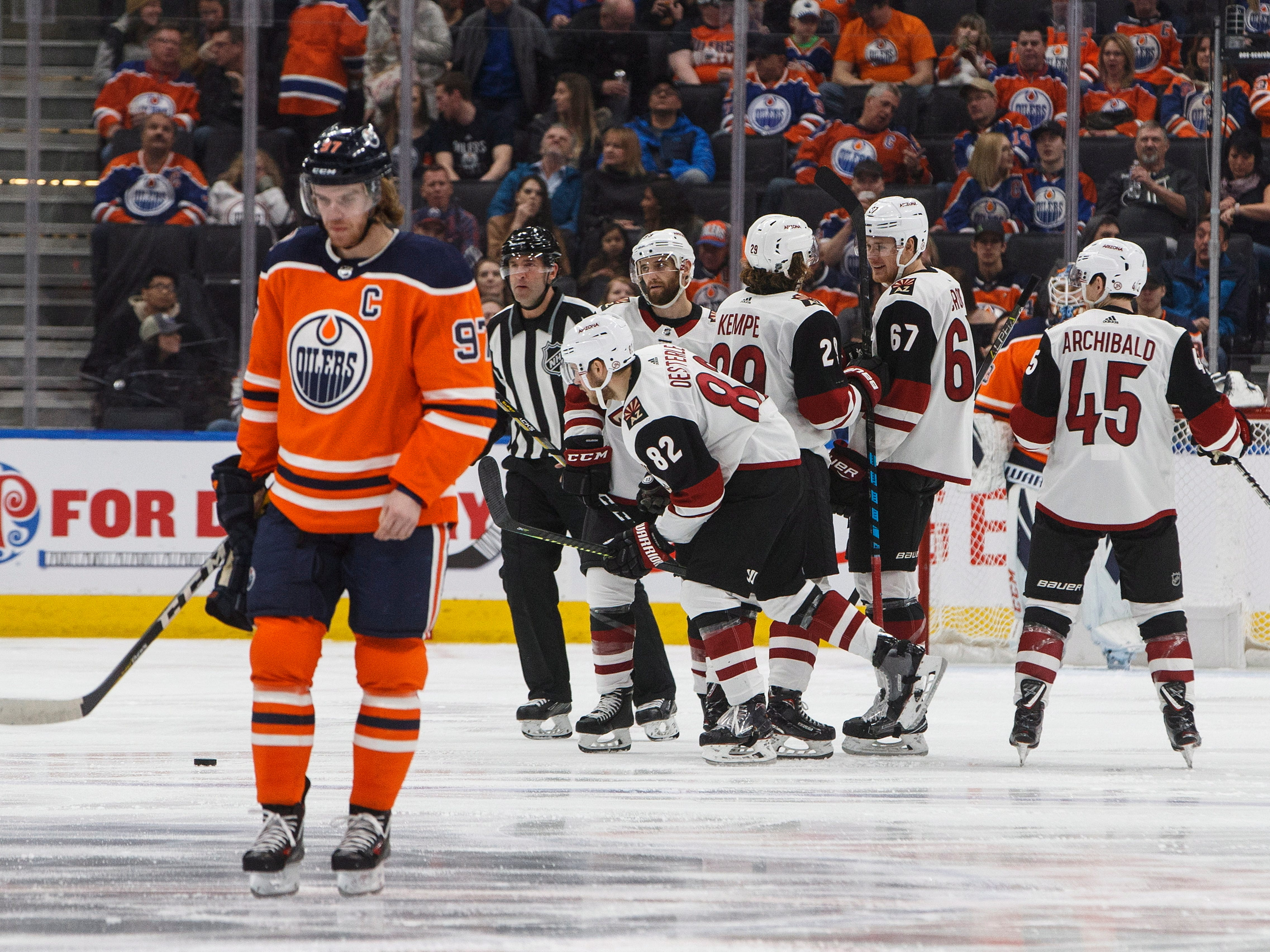 Arizona Coyotes celebrate a goal as Edmonton Oilers' Connor McDavid (97) skates past during the second period, Saturday, Jan. 12, 2019, in Edmonton Alberta. (Jason Franson/The Canadian Press via AP)