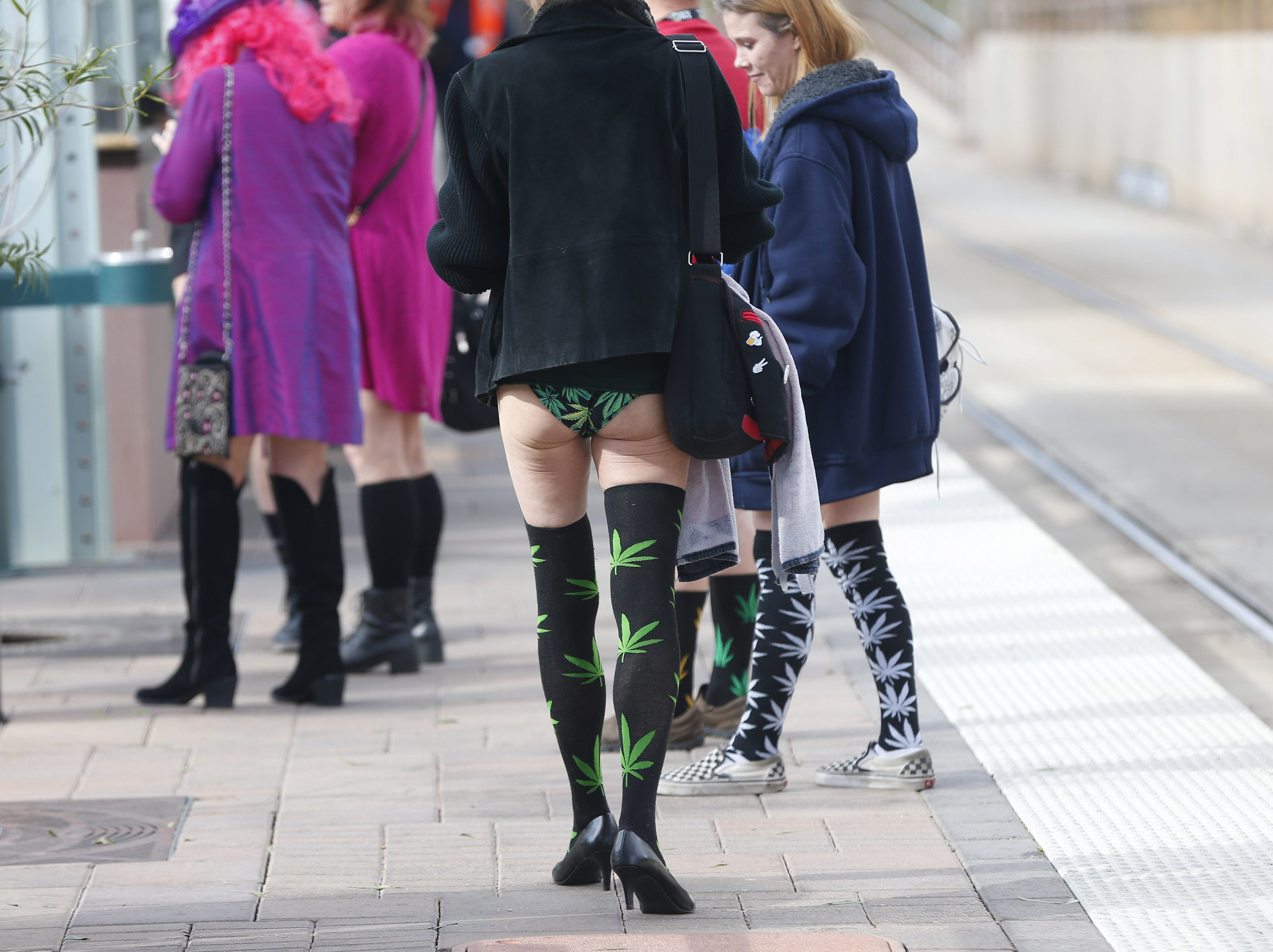 "Riders wait for a train during ""No Pants Light Rail Ride"" in Tempe, Arizona, on Jan. 13, 2019. People in dozens of cities all over the world rode public transportation without pants on the same day."