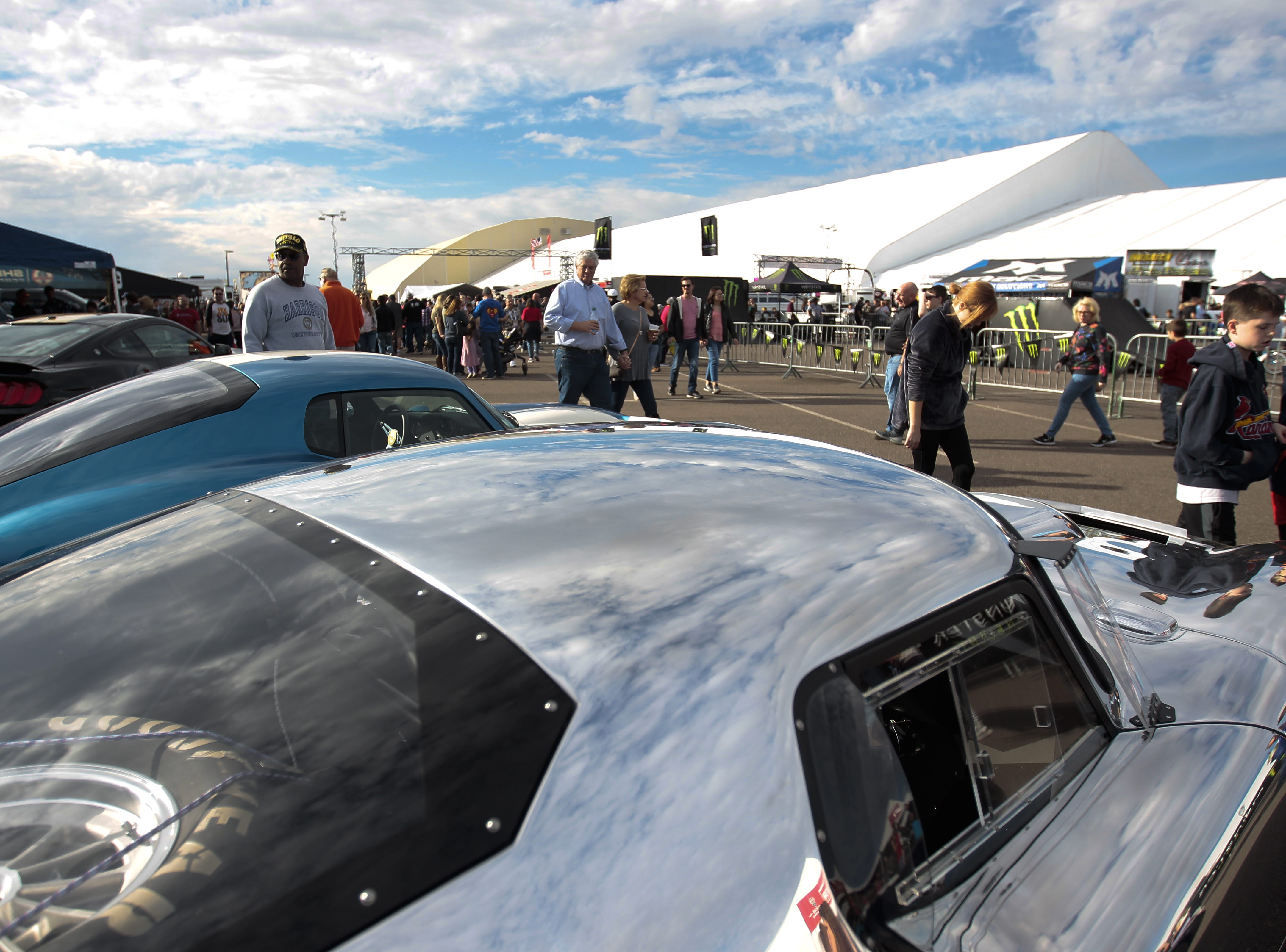 People walk by a Shelby Daytona Coupe made of aluminum at the Barrett-Jackson Car Auction on Jan. 12, the first day of the event.