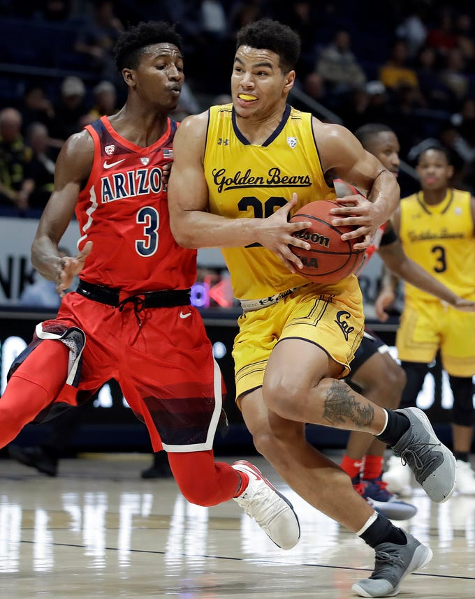California's Matt Bradley, right, drives the ball against Arizona's Dylan Smith (3) during the first half of an NCAA college basketball game Saturday, Jan. 12, 2019, in Berkeley, Calif. (AP Photo/Ben Margot)