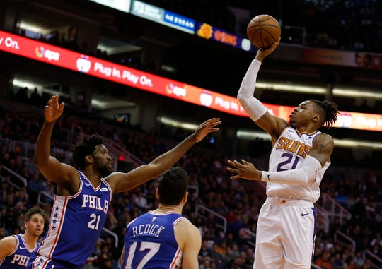 Phoenix Suns forward Richaun Holmes (21) shoots over Philadelphia 76ers center Joel Embiid (21) in the first half during an NBA basketball game, Wednesday, Jan. 2, 2019, in Phoenix. (AP Photo/Rick Scuteri)