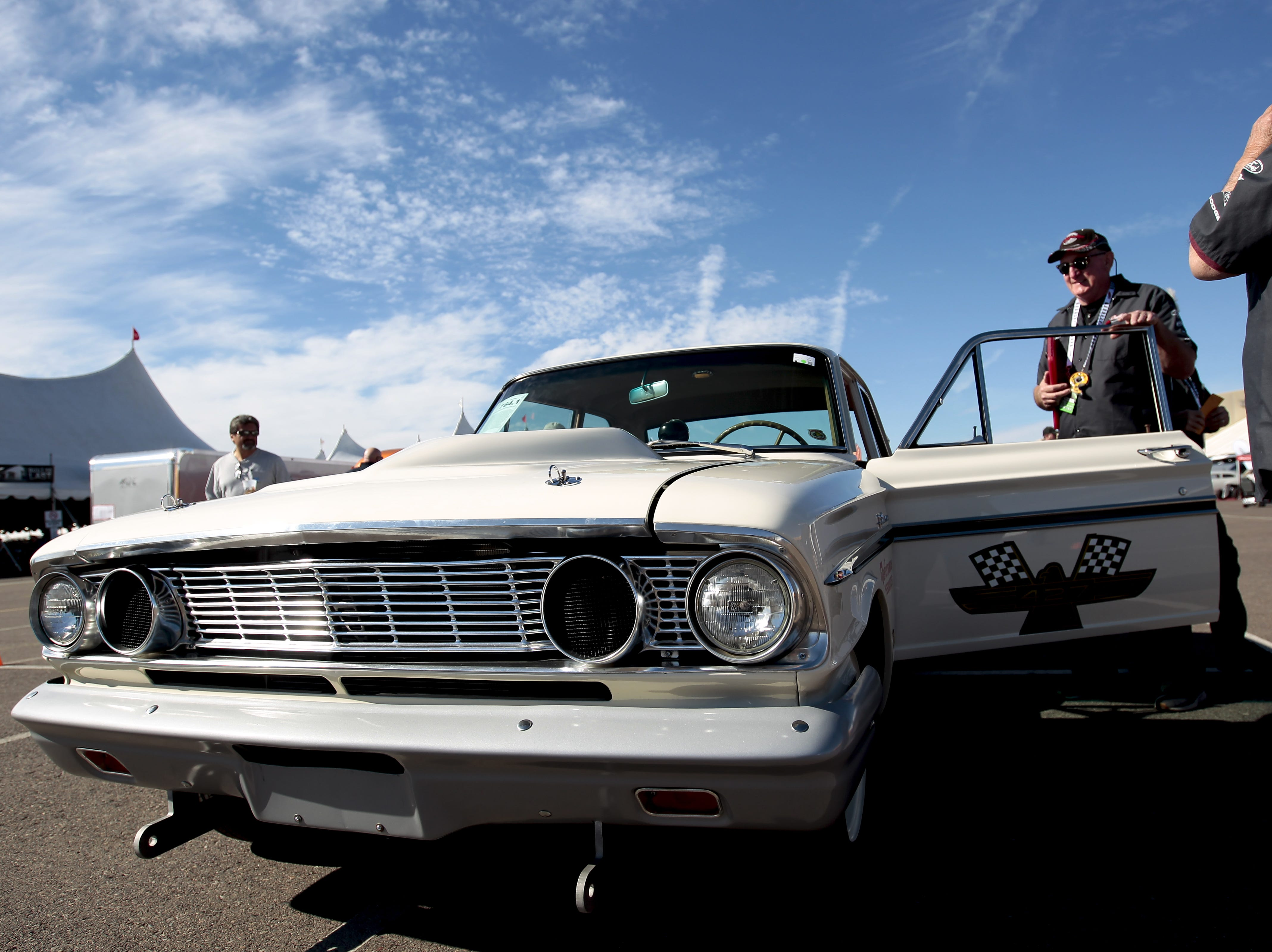 Barrett-Jackson driver Rick Eckenrode steps into a 1964 Ford Fairlane Thunderbolt Recreation on Jan. 12, the first day of the car auction.