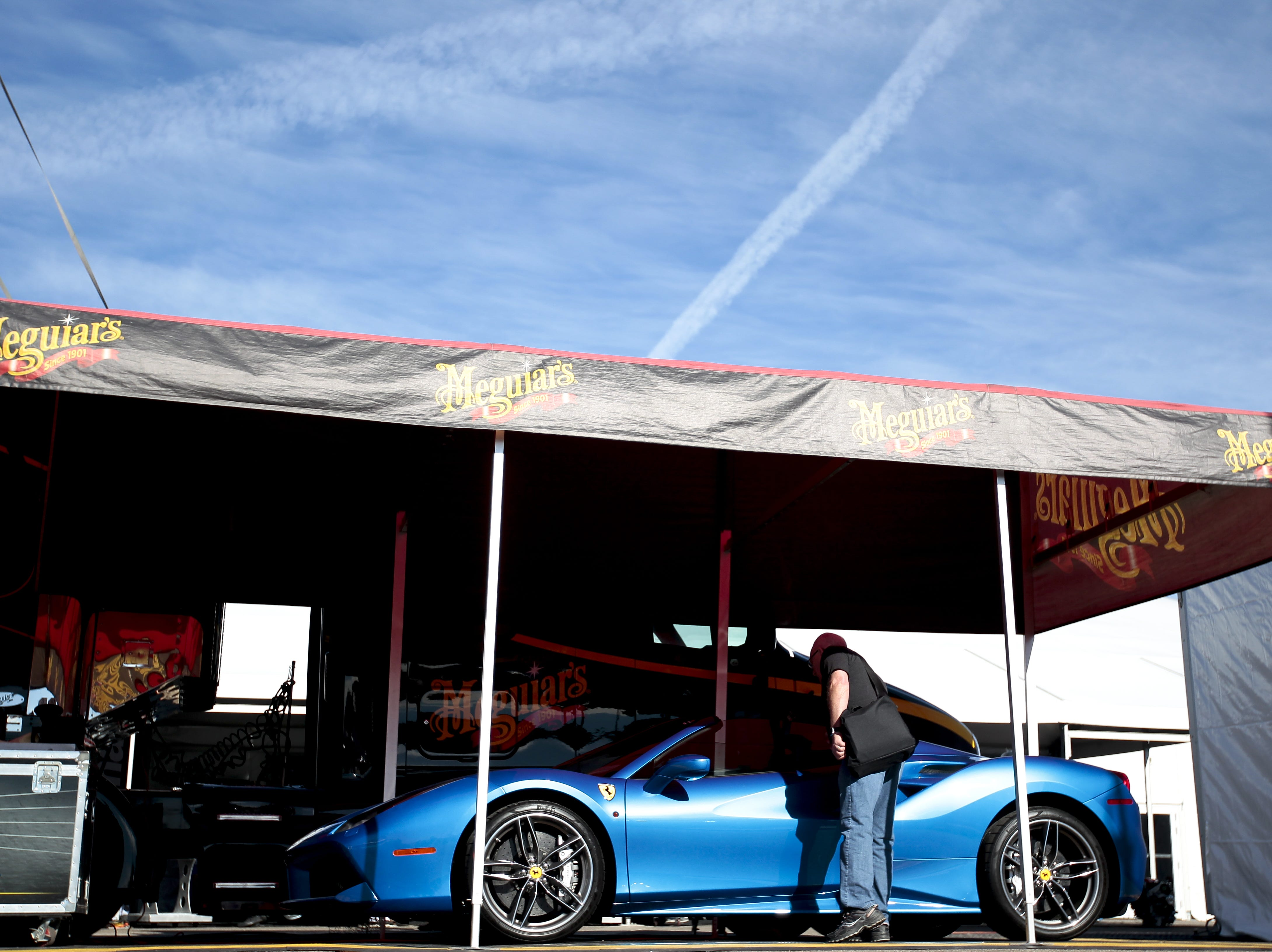A man approaches a Ferrari 488 Spider on display at the Barrett-Jackson Car Auction on Jan. 12, the first day of the event.