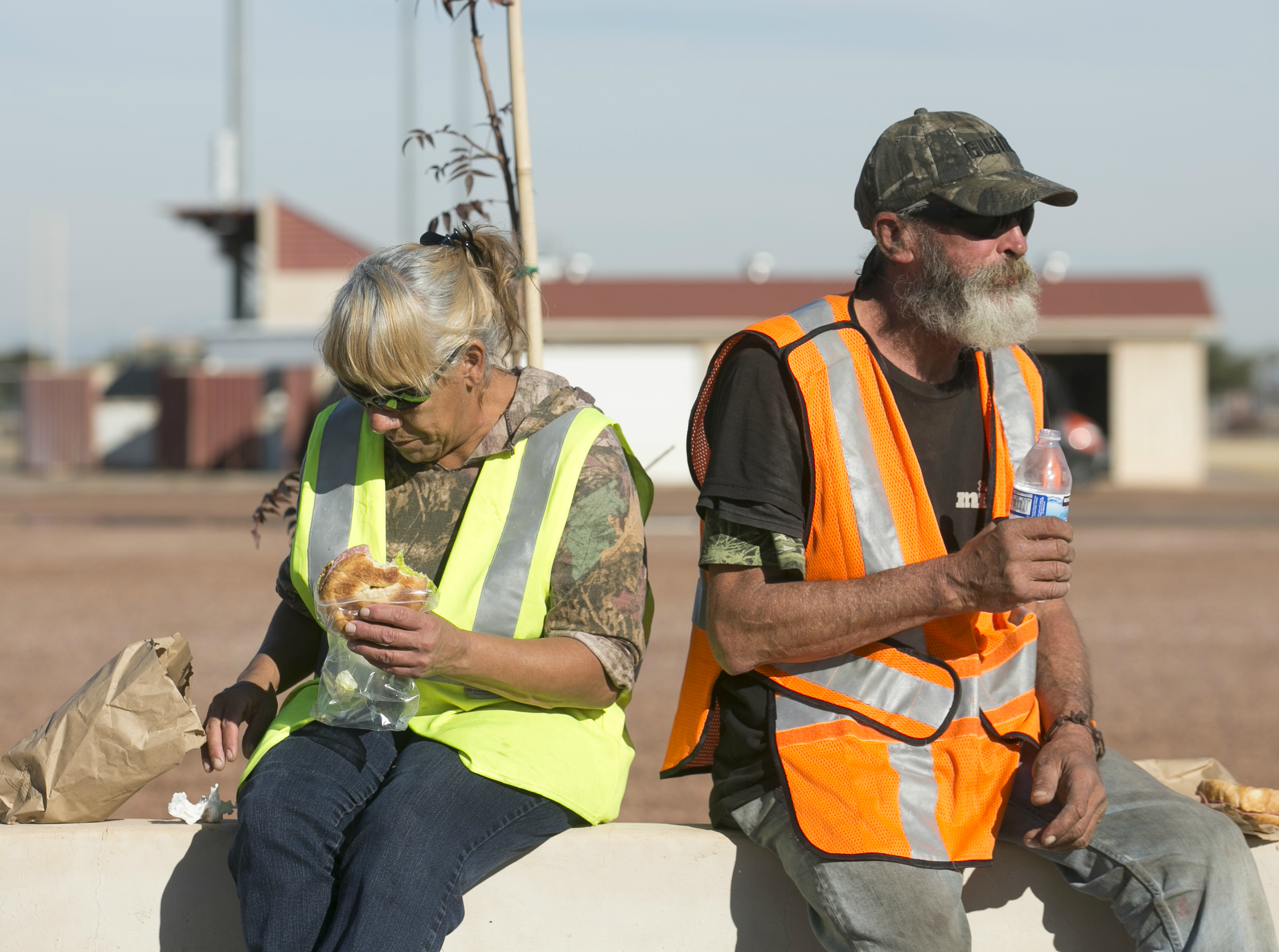 Jeanette Herring (left) sits with Robert Cutlip (right) and enjoys a lunch break while they work on cleaning Grand Canal Linear Park as part of the Phoenix Rescue Mission's Glendale Works program on Jan. 7, 2019 in Glendale, Arizona.