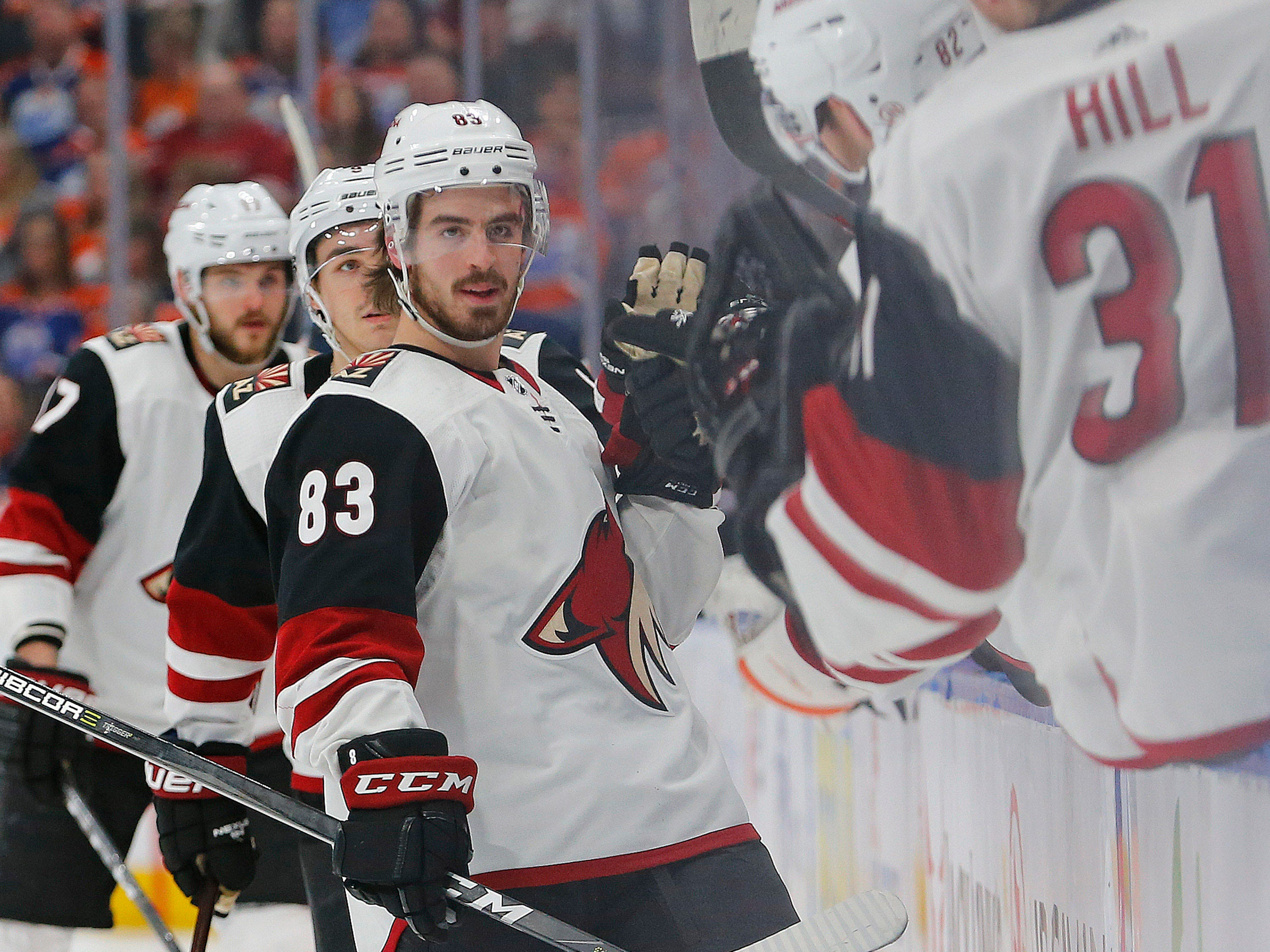 Jan 12, 2019; Edmonton, Alberta, CAN; Arizona Coyotes forward Conor Garland (83) celebrates a goal, his second of the night against the Edmonton Oilers during the third period. (Perry Nelson-USA TODAY Sports)