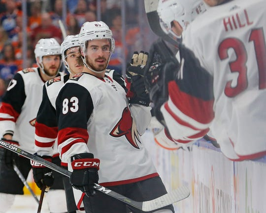 Coyotes forward Conor Garland celebrates his second goal of the night against the Oilers during a game Jan. 12.