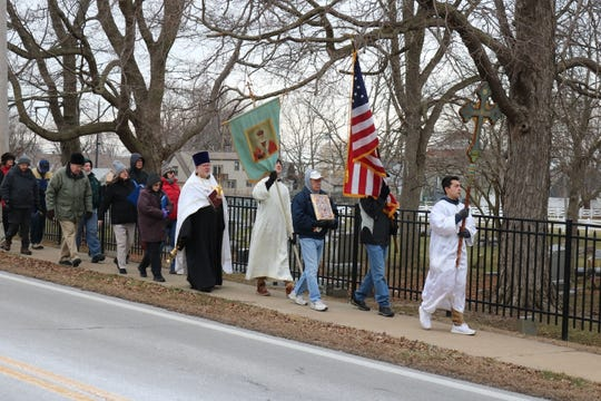 A procession heads from the Holy Assumption Orthodox Church in Marblehead to Clemons Park for the first annual Blessing of Lake Erie on Saturday.