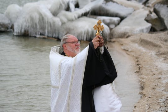 The Rev. Andrew Bartek, of the Holy Assumption Orthodox Church in Marblehead, performs the first annual Blessing of Lake Erie at Clemons Park on Saturday.