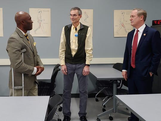 From left, Penn State Mont Alto Chancellor Francis K. Achampong; Dr. Daniel Dandy, academic coordinator of clinical education; and U.S. Rep. John Joyce, discuss allied health programs during Joyce's visit to PSMA on Friday, Jan. 11, 2019.