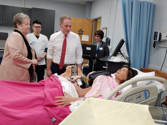 U.S. Rep. John Joyce looks over Lucina, a birthing simulator, at Penn State Mont Alto during a visit on Friday, Jan. 11, 2019. Also pictured are, from left,  Dr. Carranda Barkdoll, nursing programs coordinator, and Ben Cai, a nursing student.