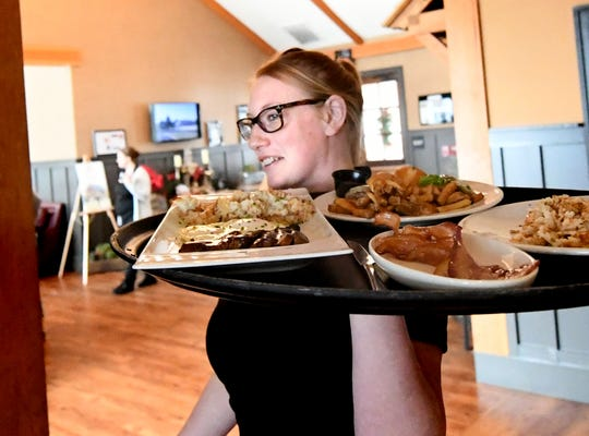 Server Katlyn Wildberger delivers a meal at Wyndridge Farm Sunday, Jan. 13, 2019. The Dallastown business has been named the sole grower and processor of hemp for Albright College's research of the fibrous material originating from the cannabis plant. Bill Kalina photo