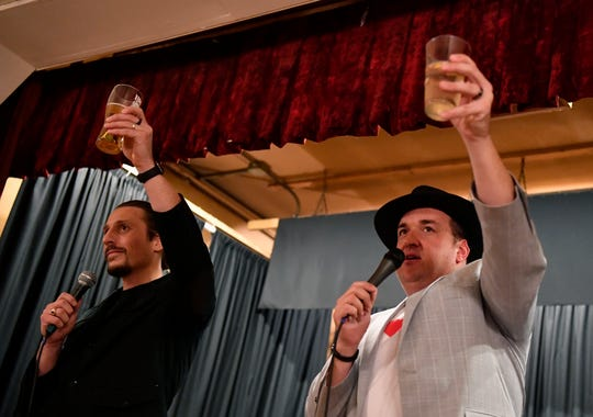 Adam Nugent, left, and Adam McCallister toast Doug Knight as his family and friends gather to celebrate the life of York's greatest cheerleader, Saturday, January 11, 2019.John A. Pavoncello photo