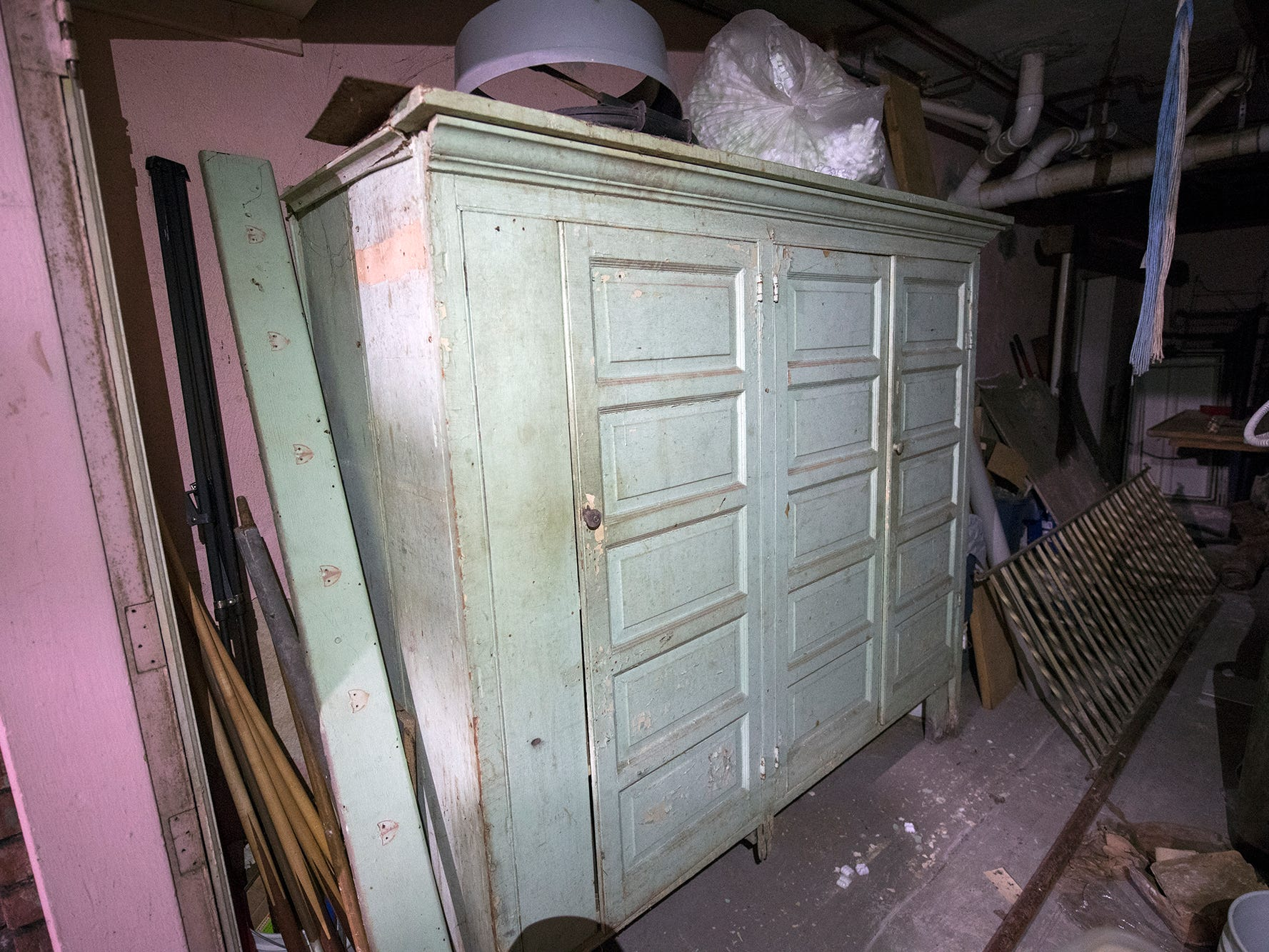 An old paneled cabinet sits in the basement of the former Cobblestones building on Wednesday January 9, 2019.