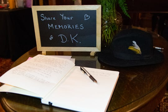 As guests enter, they share their fondest memories of Douglas Knight by writing a personal story into a notebook, January 12, 2019.