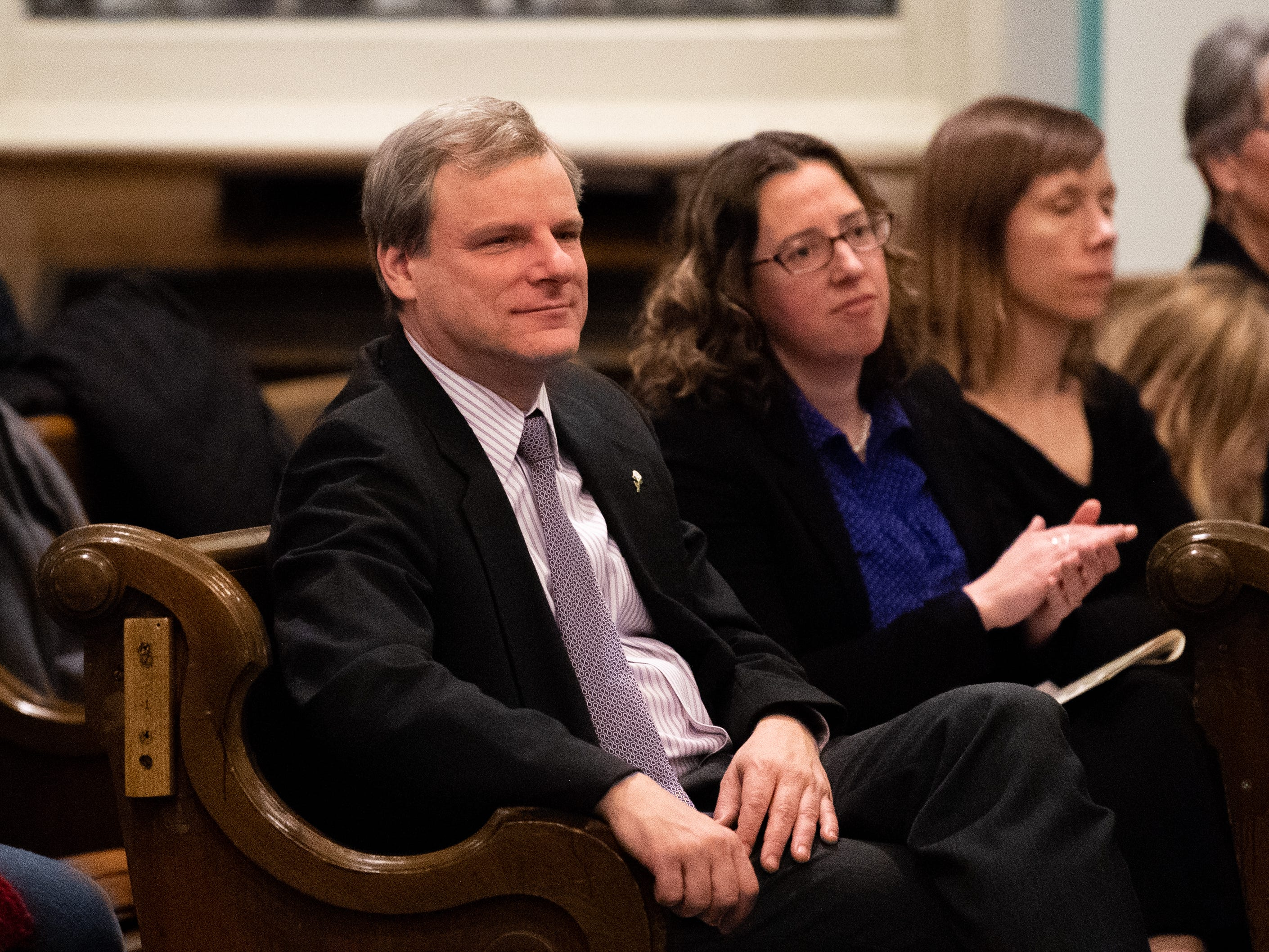 Mayor Michael Helfrich sits in the front row enjoying the band during the 21st annual Jazz Vespers concert at First Presbyterian Church in York, January 12, 2019.