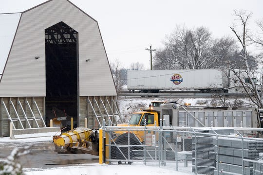 The PennDOT salt storage area was busy on Sunday morning January 13, 2019, while traffic flowed freely on Interstate 83 in the background.