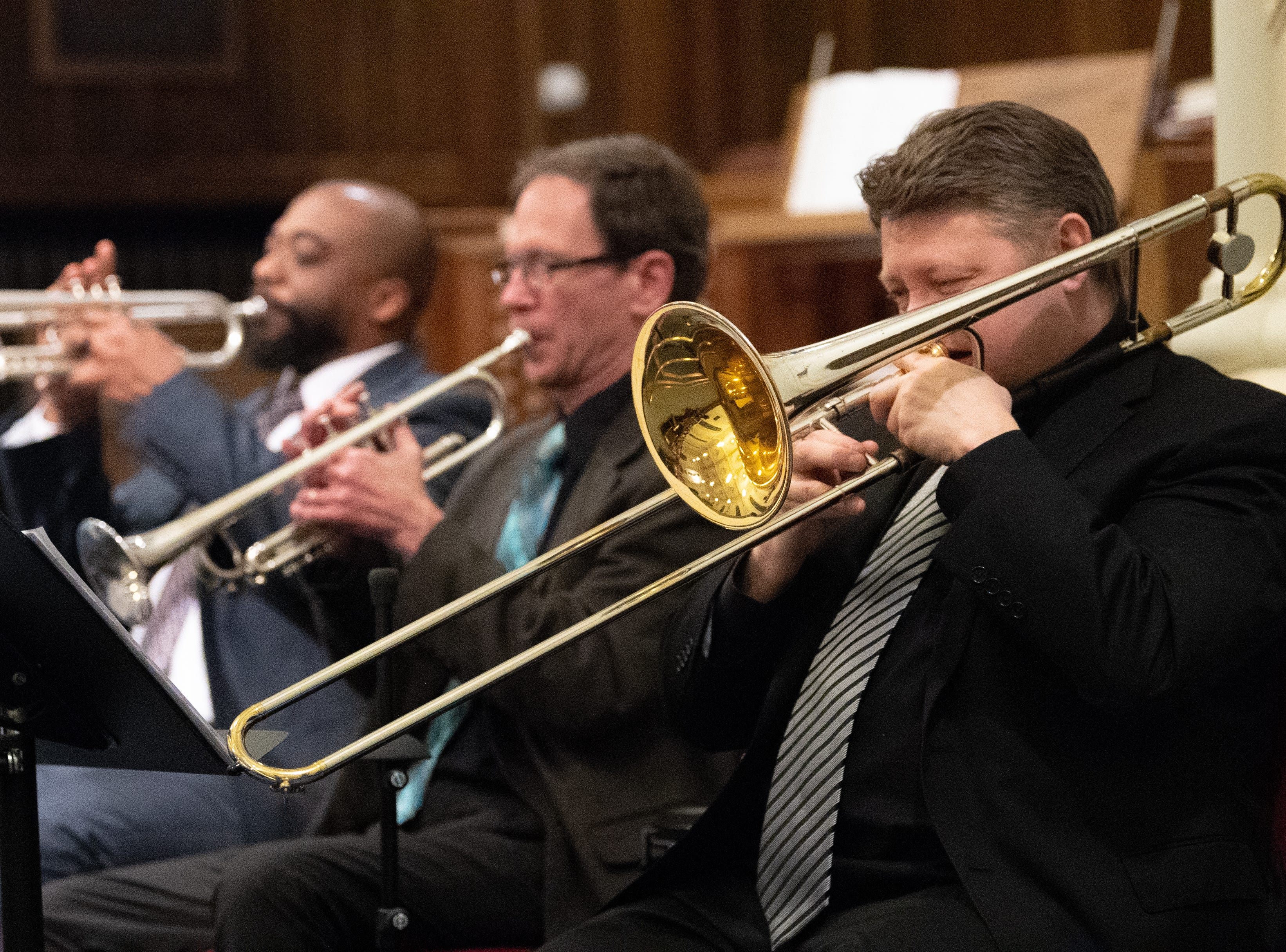The horn section swings with the music during the 21st annual Jazz Vespers concert at First Presbyterian Church in York, January 12, 2019.