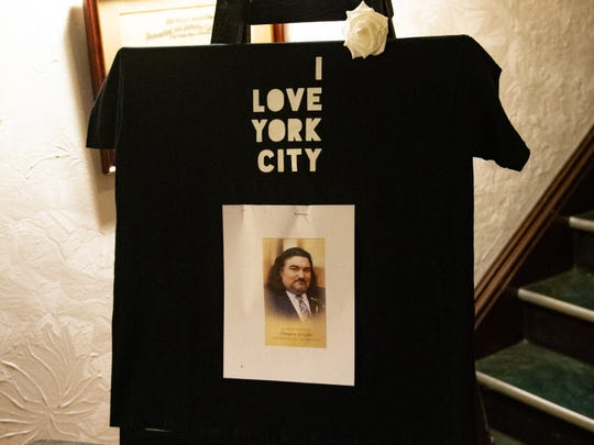 "An ""I Love York City"" shirt with Douglas Knight's face on it greets guests as they enter the Elks Lodge for the celebration of Knight's life on Jan. 12, 2019."