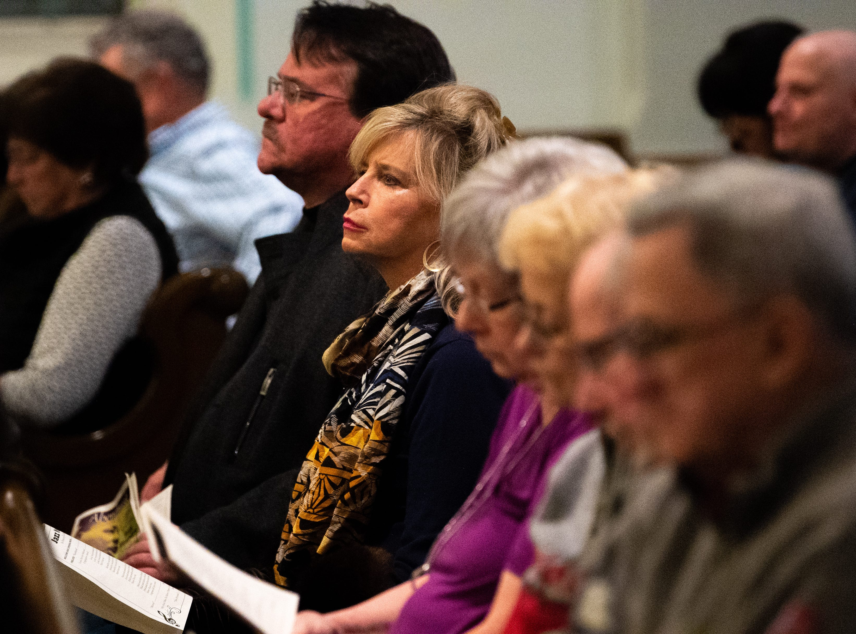 In the middle of the concert, the audience says a prayer with Rev. Allison Beaulieu, January 12, 2019.