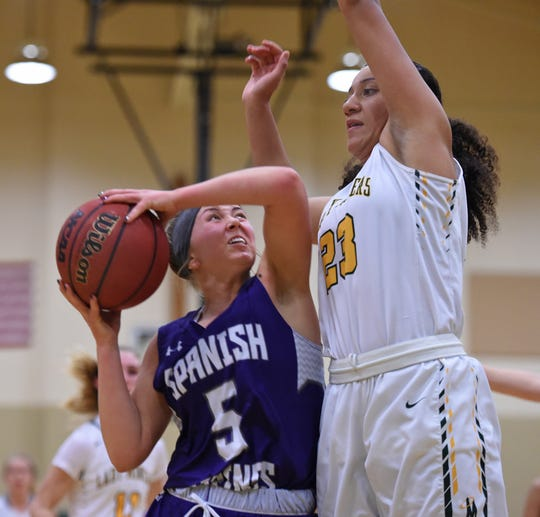 Bishop Manogue's Amaya McLeod covers Spanish Springs' Magan Gower as she shoots during Thursday's game at Bishop Manogue. Spanish Spring won 51-48.