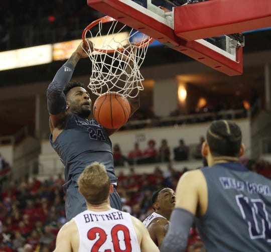 Nevada's Jordan Caroline dunks Saturday against Fresno State for two of his 19 points.