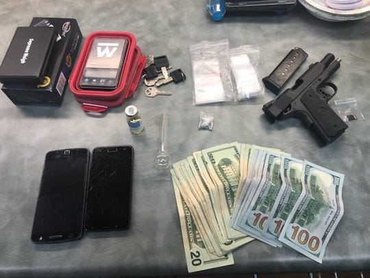 The Carson City Sheriff's Office released a photo of items they found while searching a drug suspect's home. Authorities found a stolen semi-automatic pistol, $1,400 cash and a baggie with 310 grams of methamphetamines during a search of a home in Carson City on Jan. 12, 2019.
