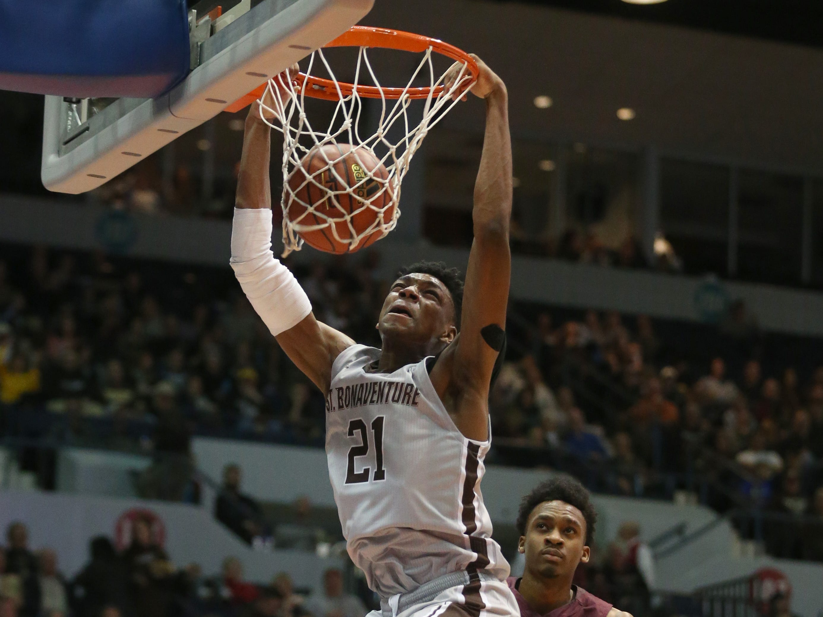 St. Bonaventure's Osun Osunniyi slams home two points over Fordham's Jalen Cobb in the first half.