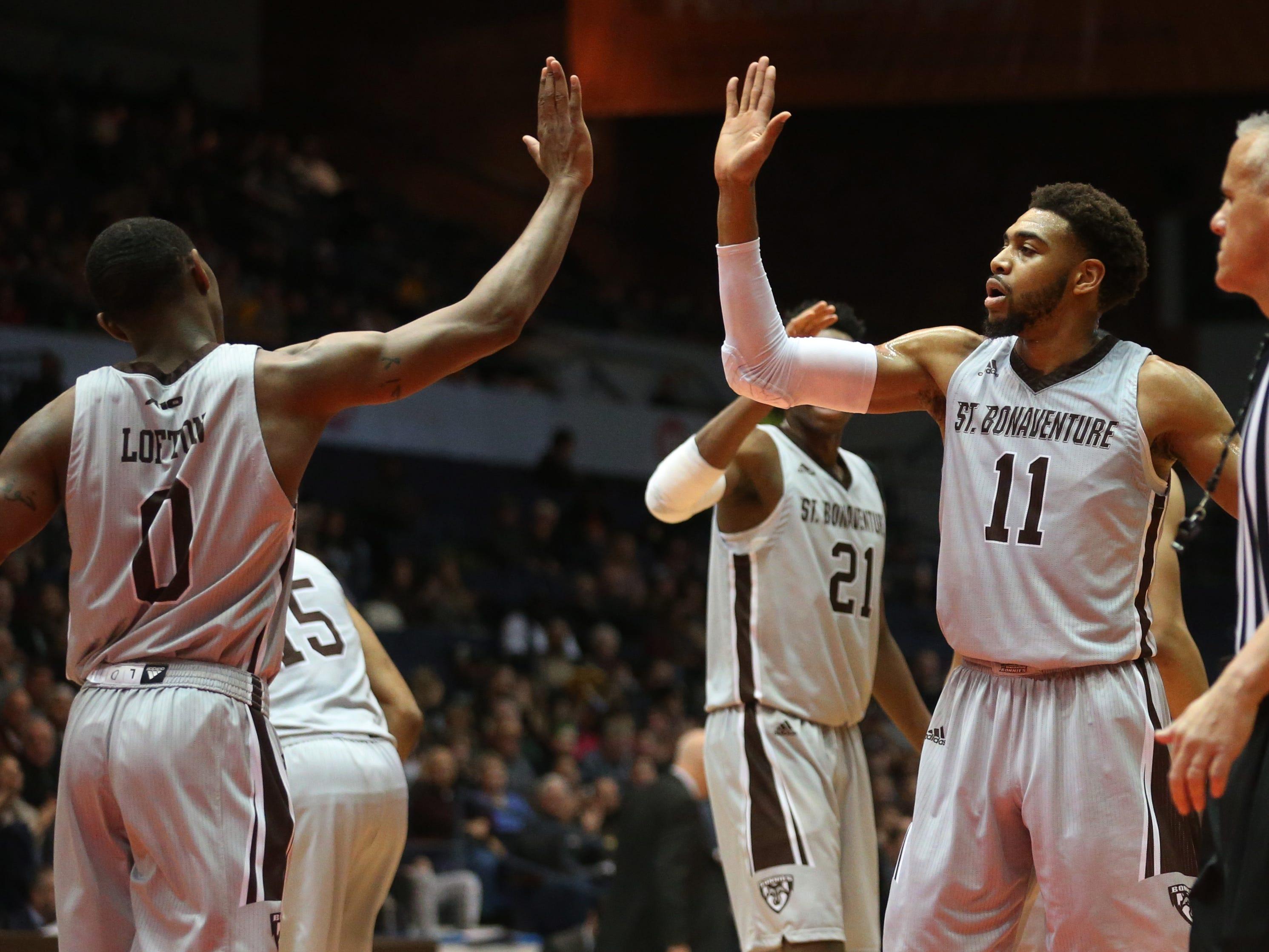 St. Bonaventure's Kyle Lofton, left, celebrates his basket with teammate Courtney Stockard.