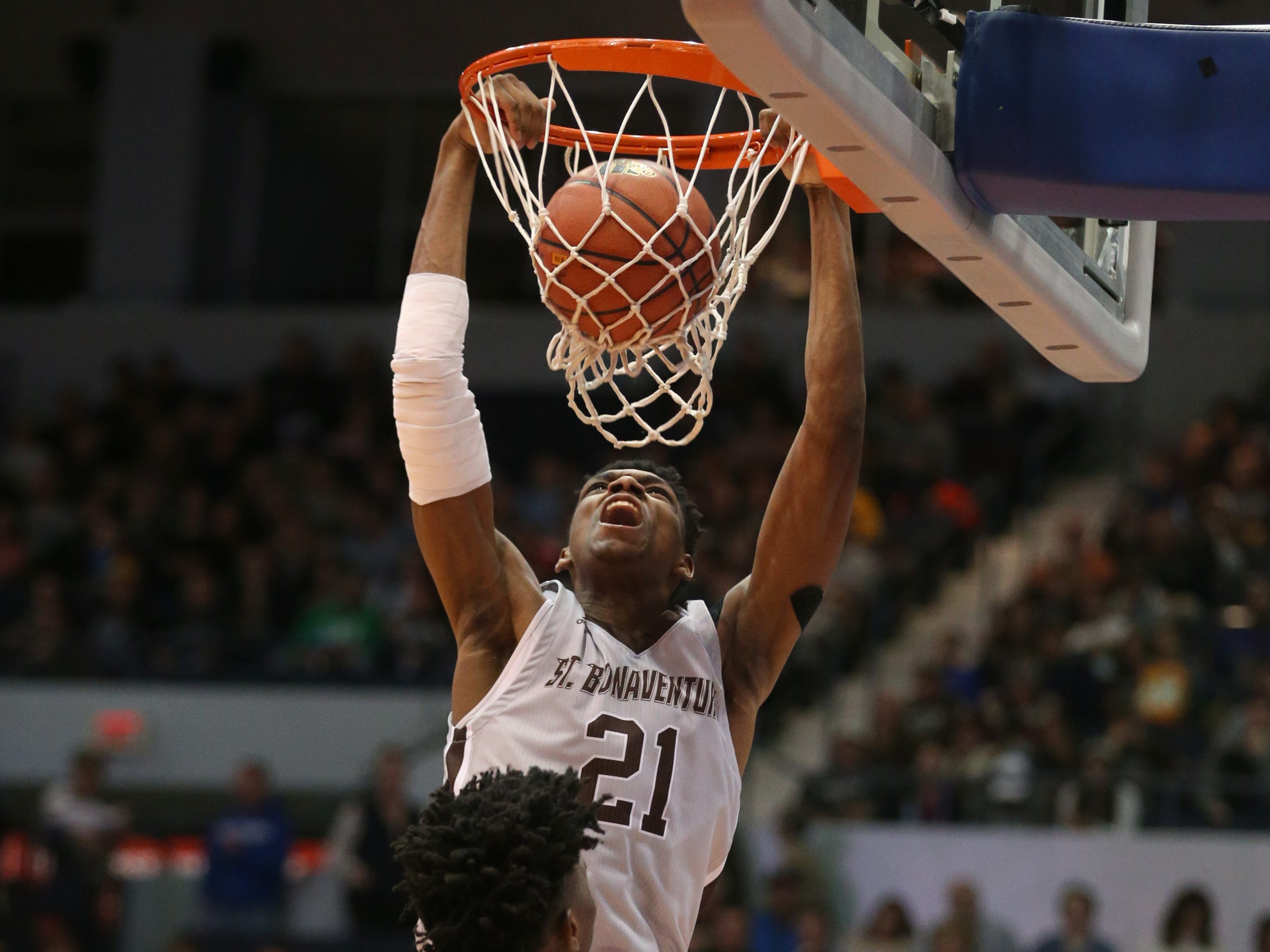 St. Bonaventure's Osun Osunniyi slams home two points late in the game against Fordham.