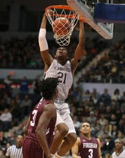 St. Bonaventure's Osun Osunniyi slams home two points late in the game against Fordham during their game at the Blue Cross Arena in Rochester Saturday, Jan. 12, 2019.  The Bonnies won the game 71-44.