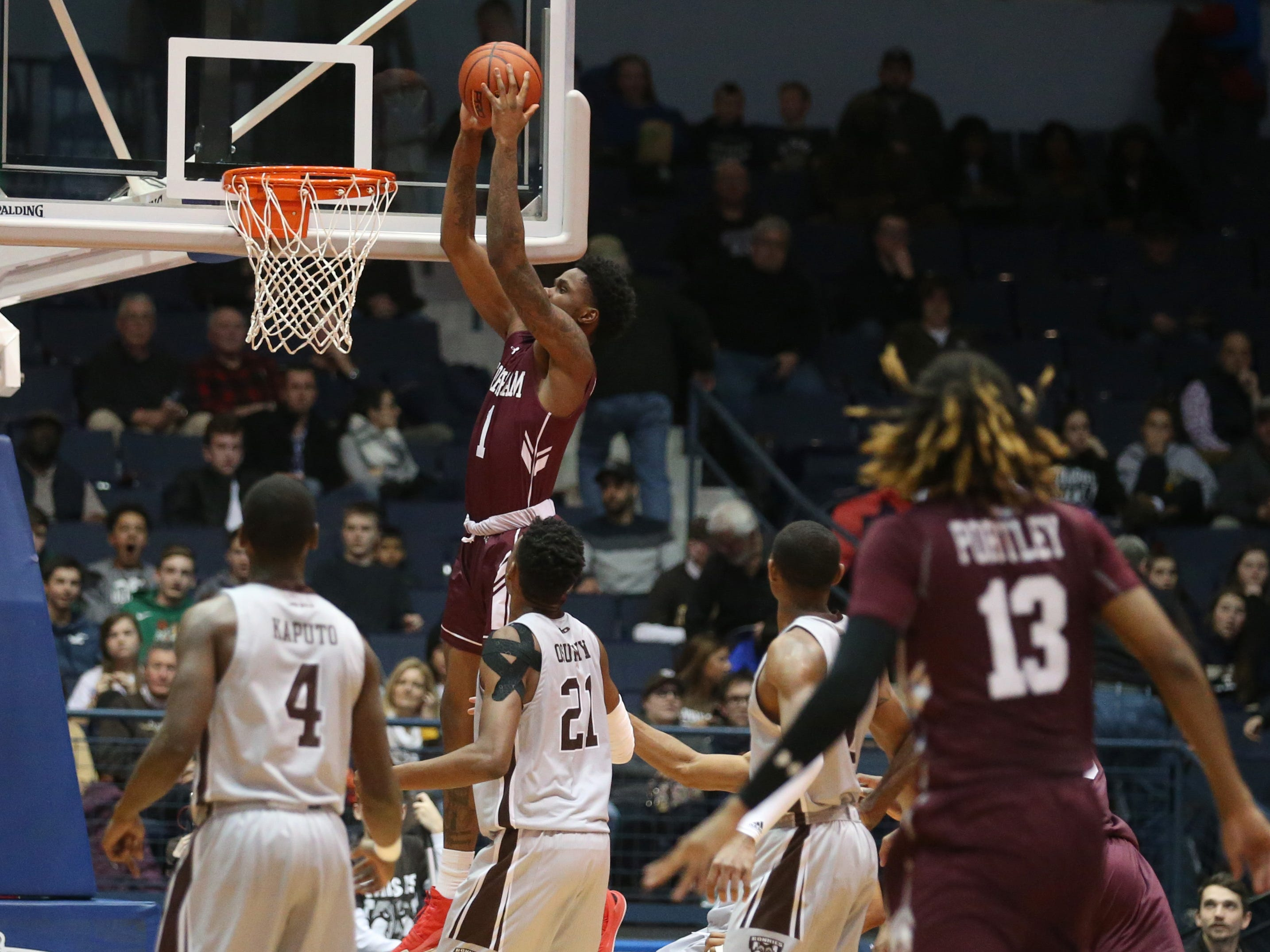 Fordham's Chuba Ohams slips in behind the St. Bonaventure defense for an alley-oop dunk late in second half.