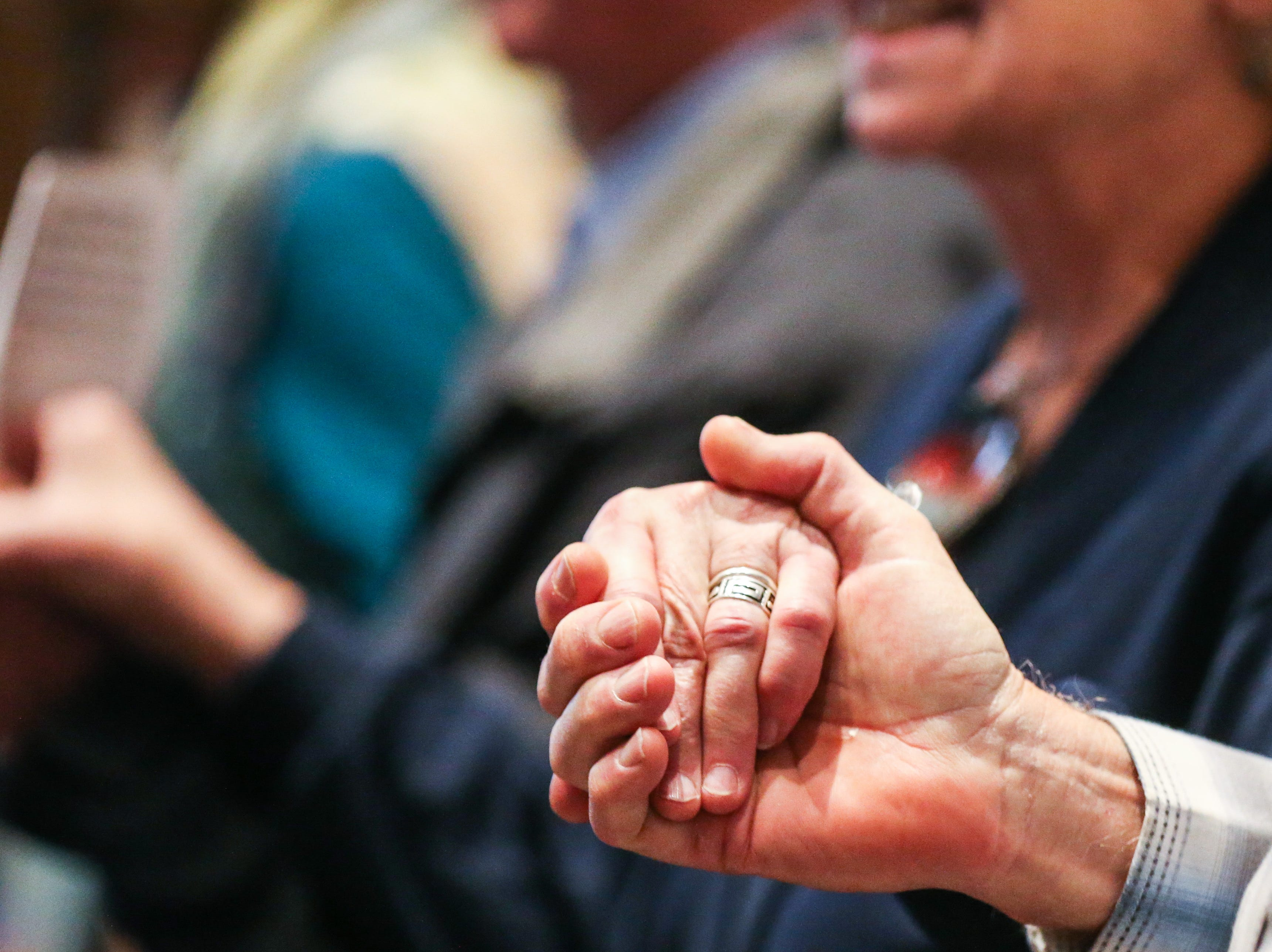 """Everyone held hands while singing """"Amazing Grace"""" during the Celebration of Spirit for Roger Allen Sunday, Jan. 13, 2019, at San Angelo Museum of Fine Arts."""